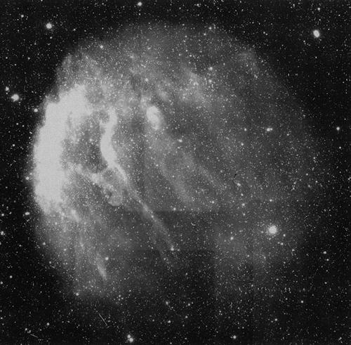 The closest planetary nebula Sh 2-216, viewed with the Burrell-Schmidt in 1995, filtering for the light of ionised nitrogen (technically [N II]). Overexposed to reveal the faint stuff.