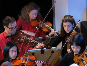 Jen among the first violins in the All Sould Orchestra.