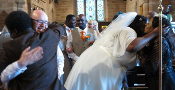 Craig & Vangeya Murphy - just married and processing out of church