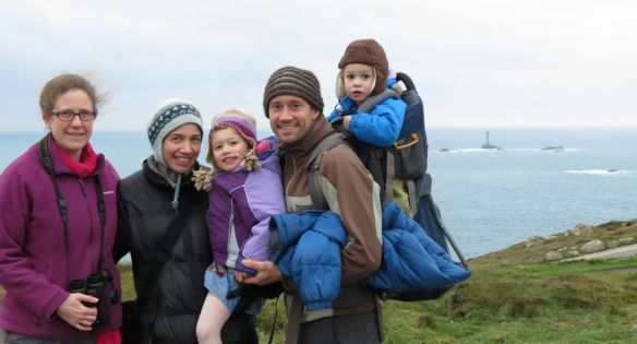 Jen with Rachel, Sophie, Andrew and George, blown around by the wind at Land's End